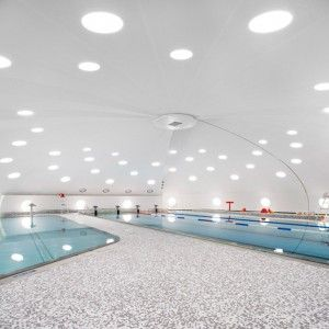 Urbane Kultur adds boomerang-shaped extension to domed Tournesol swimming pool