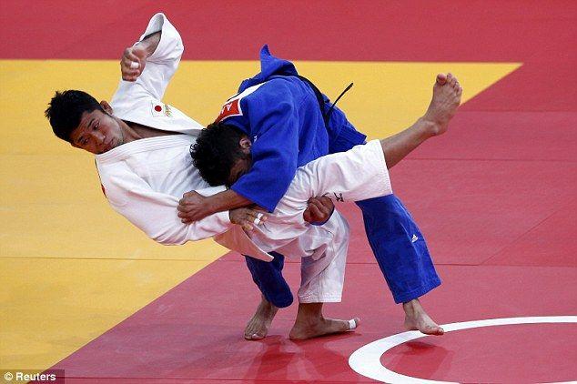 Japan's Hiroaki Hiraoka fights with Britain's Ashley Mckenzie (blue)
