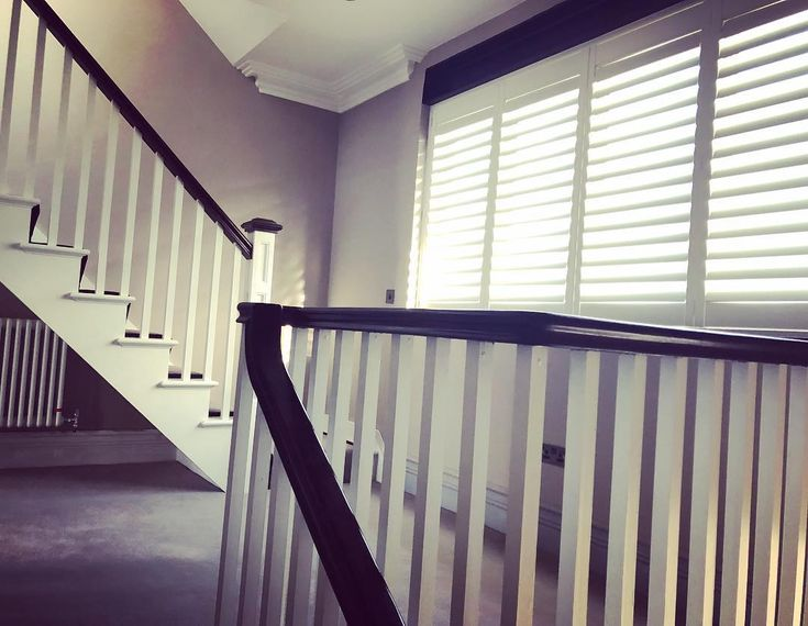Shutters were the perfect way to dress this large window to complement my clients new england style staircase. #recent #blackandwhiteinterior #newenglandstyle #shuttersdublin #shuttersireland #irishhomes #shuttterco #newhampshireinteriors