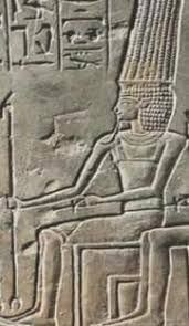 Anuheru (Anhur) - means 'Horus of the Beautiful House'. Venerated in the area of Abdju (Abydos), and particularly in Thinis. One of his titles was Slayer of Enemies. Anuheru was depicted as a bearded man wearing a robe and a headdress with four feathers, holding a spear or lance, or occasionally as a lion-headed god..