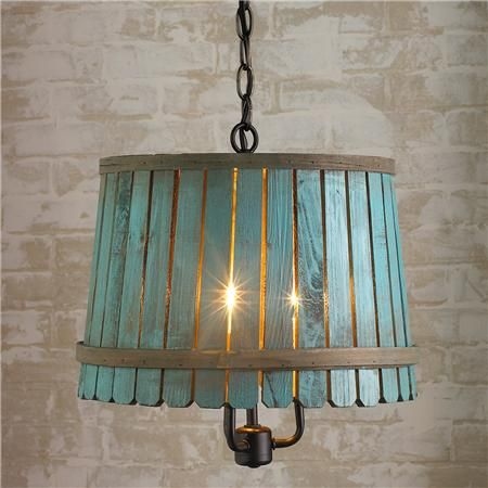 i think this could be a diy project. a thrifted light fixture, two barrel or embroidery hoops and some paint stir sticks. Voila, a new light fixture!