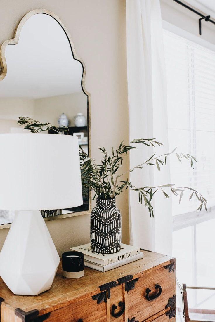 metallic mirror, white mod lamp and textured wood combo