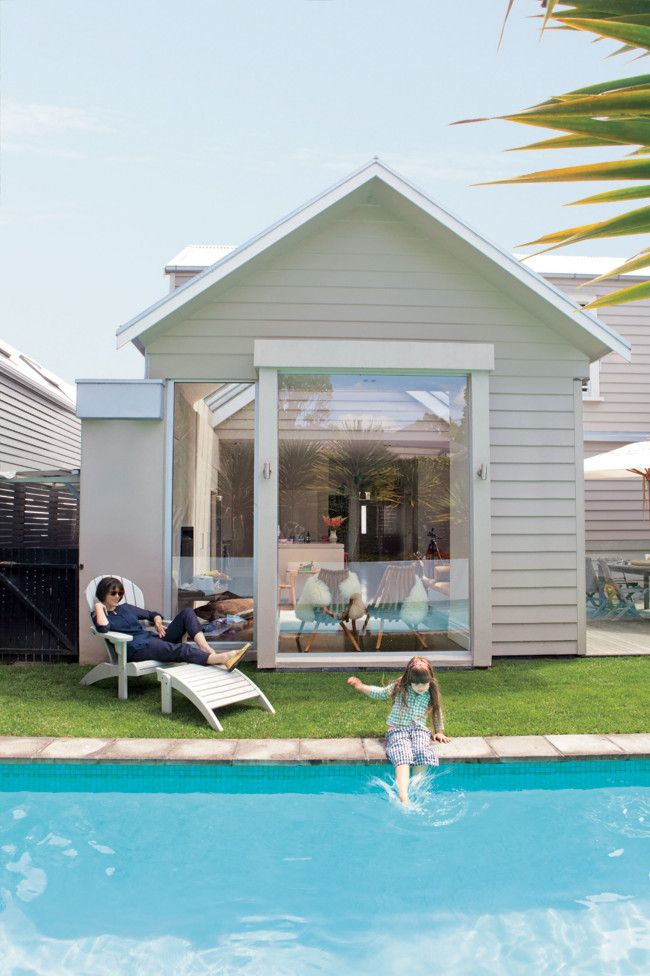 Weatherboard + large windows + central courtyard + pool