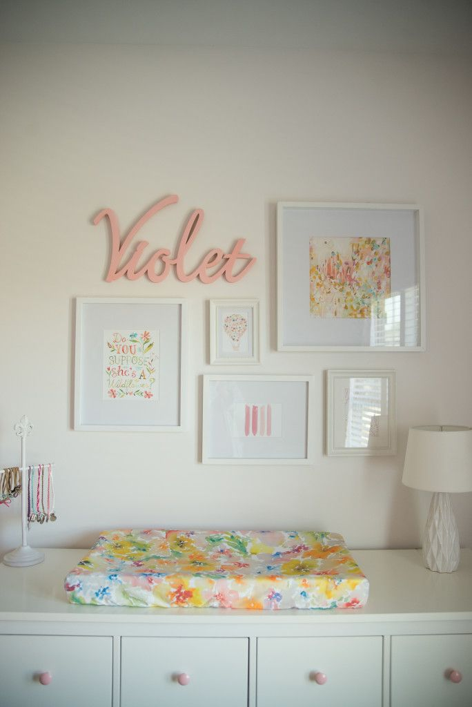 mini gallery wall over the changing table love the pop of floral - Baby Wall Designs