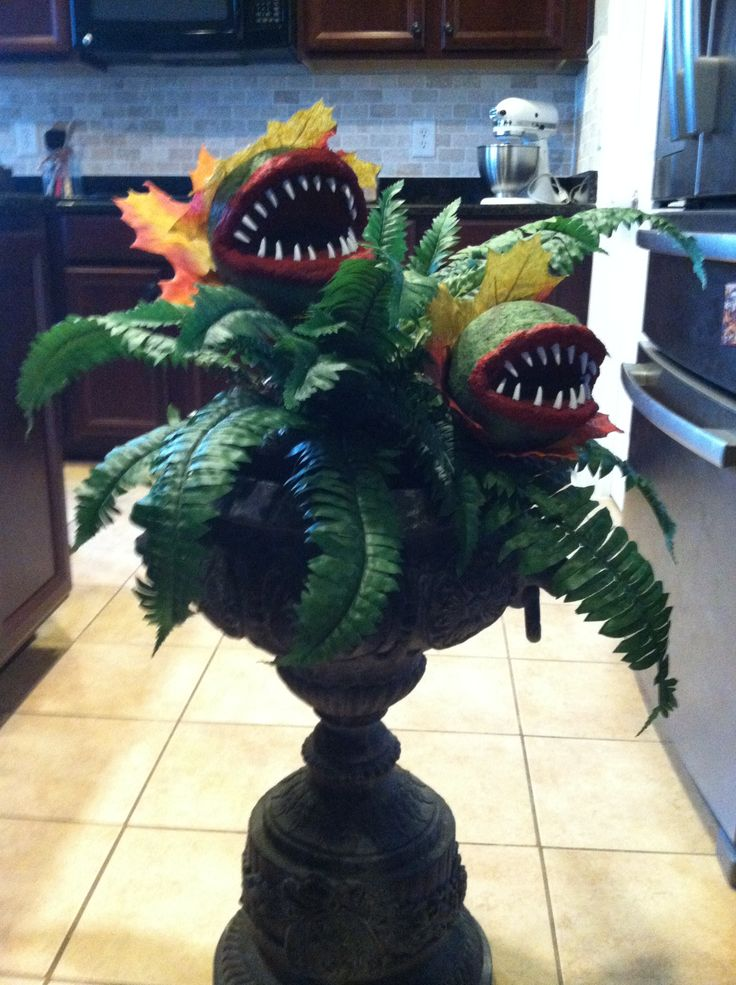 My DIY little shop of horrors plant- styrofoam balls cut, paper mached, and painted with resin teeth from etsy. Then great stuffed into old plastic container with fake fern so it can be placed in any potter. Stems are PVC pipe.