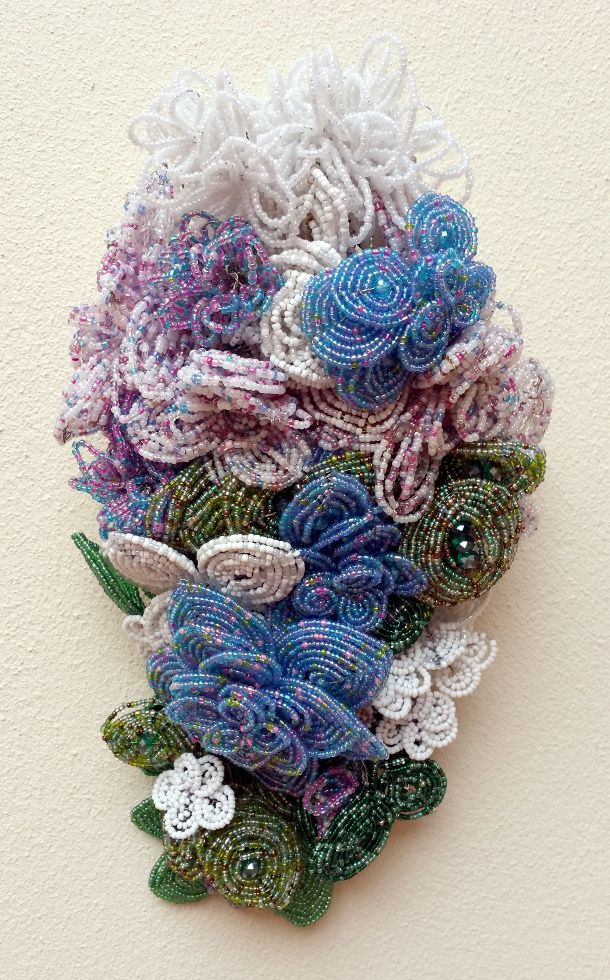 A beautiful cascade bouquet made of glass seed beads and crystals. Whites, blues and lovely leafy greens. Created by Annalee Beer of EverAfter Artisanry.