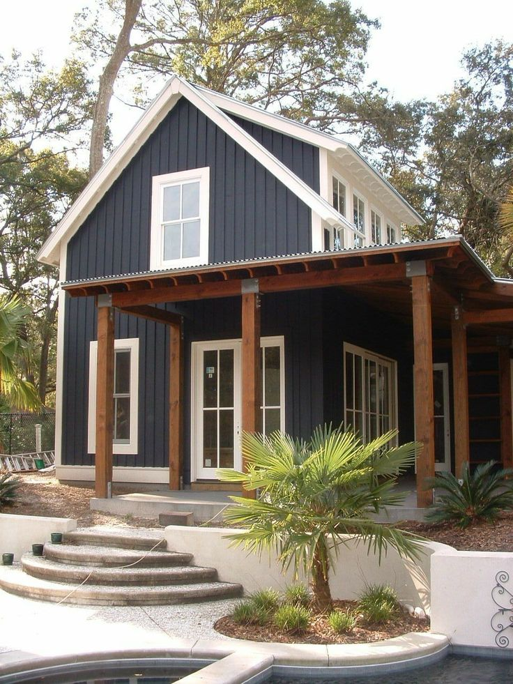 Vertical siding with metal roof