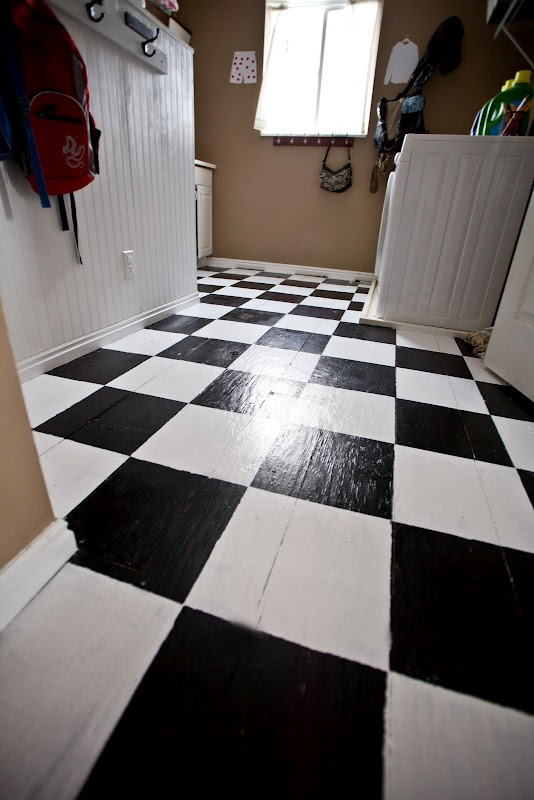Plywood floor   8 inch wide planks of plywood  laid right over  linoleum vinyl  painted white  then later painted black checks  Great job. 33 best images about Painted Plywood Floor Ideas on Pinterest