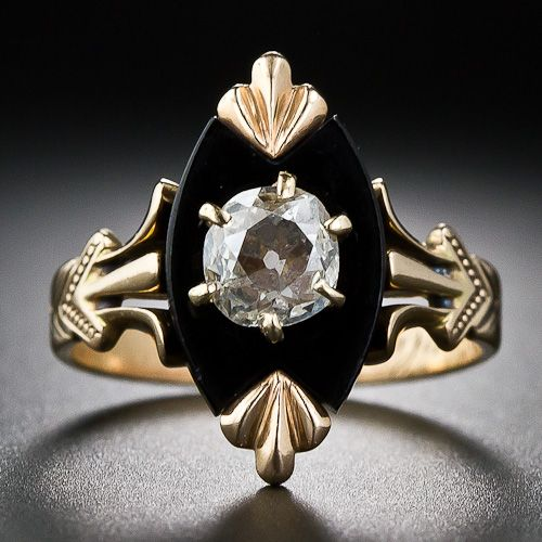 Distinctive and dramatic original antique Victorian ring, circa 1875 and crafted in rose gold, features a shallow, asymmetrically cut, old-mine diamond set into the center of a black onyx plaque which is beautifully ornamented on all sides