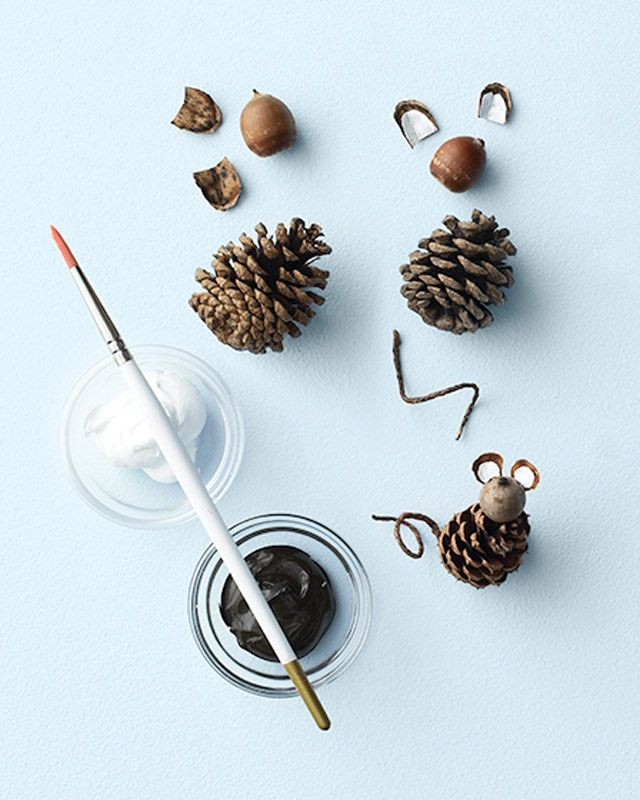 Scissors  2 large pinecone scales (for ears)  White and brown acrylic paint  Small paintbrushes  1 short piece of twine (for tail)  1 egg-shape pinecone (for body; other shapes will work, too)  Craft glue  1 acorn (cap removed, for head)