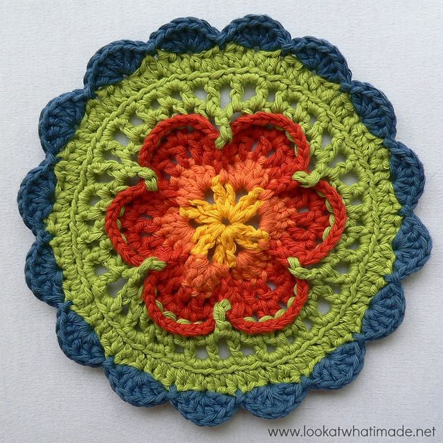 The first 6 rounds of this Mandala were heavily inspired by Chris Simon's Lace Petals Square. In fact, if you take away the front post stitches and back loop stitches, it is an unashamed copy of Chris' gorgeous design.