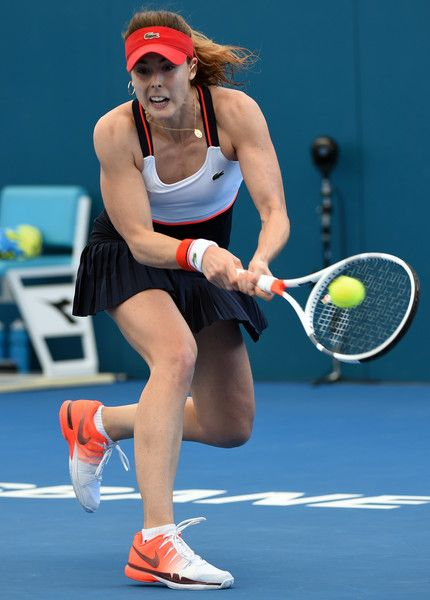 Alize Cornet of France hits a return against Elena Vesnina of Russia during the first round of the Brisbane International tennis tournament in Brisbane on January 1, 2017. / AFP / SAEED KHAN / --IMAGE RESTRICTED TO EDITORIAL USE - STRICTLY NO COMMERCIAL USE--