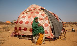 A mother and her child seek shelter at the Doolow refugee camp after fleeing drought in territory occupied by al-Shabaab.