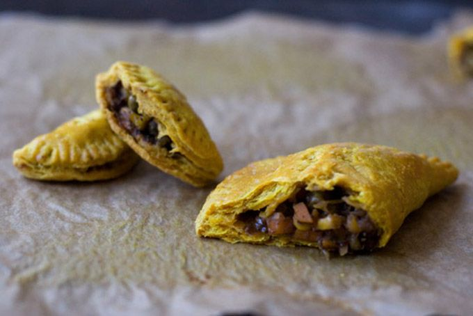 Jamaican Veggie Patties (turnovers)...an easy vegan pastry crust filled with veggies like potatoes, corn, peas, herbs and spices and then baked until golden brown. Good picnic or take-along-for-the-ride food.
