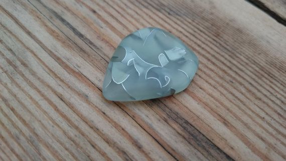 Check out this item in my Etsy shop https://www.etsy.com/dk-en/listing/264270775/plunk-heavy-glow-in-the-dark-plectrum