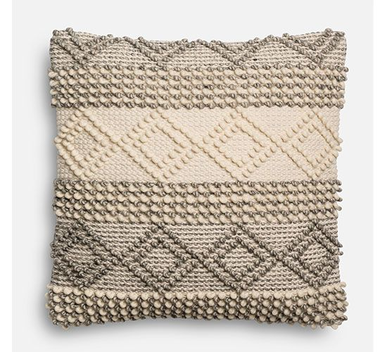 Easily add a touch of texture to your space with this plush, oversized pillow.