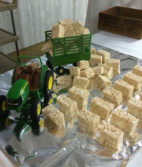 Tractor carrying Rice Krispie Treats. Cute idea for a Boy's Birthday Party! Cheaper and Easier than making or buying a cake! All kids love them!