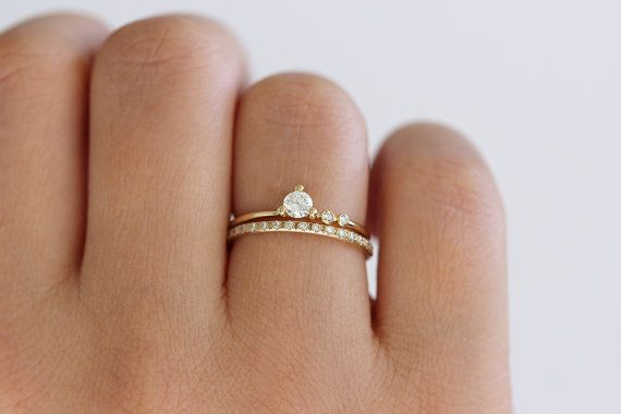 Delicate asymmetric engagement ring in 18k solid gold with a sparkly 0.2 carat center diamond.  Materials: 18k solid yellow gold | 0.2 carat round diamond (3.5 mm) | 1.5 mm round diamond | 1.2 mm round diamond Diamonds parameters: excellent cut, VS clarity, color E-G, conflict free The band is 1.3 mm thick.  ► Can be made in YELLOW, WHITE or ROSE 18k gold > select your preferred material in the listing options.  Makes a beautiful wedding set with our: Thin diamond eternity ring…