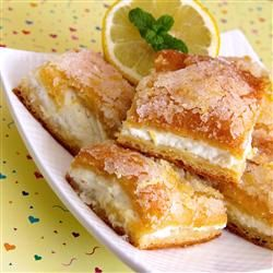 Lemon Cream Cheese Bars - A simple recipe using crescent roll dough, lemons, cream cheese, sugar butter.