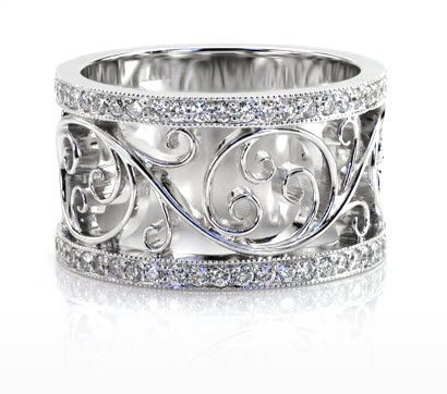 Filigree Wedding Band featuring bead set diamond rails with milgrain framing a beautiful flowing scroll pattern.