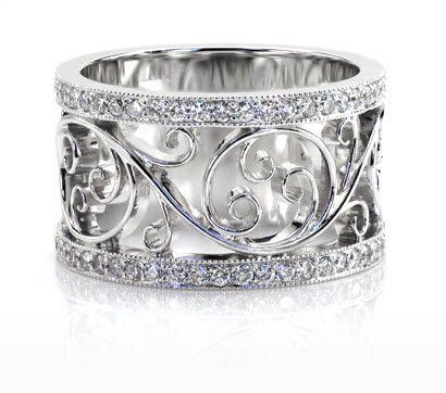 Stunning Filigree Wedding Band featuring bead set diamond rails with milgrain framing a beautiful flowing scroll pattern