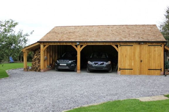 Our Standard Garage With Log Store Partition Wall Oak Double Garage Doors Cedar Shingle Roof Shedplan Double Garage Door Double Garage Timber Frame Garage