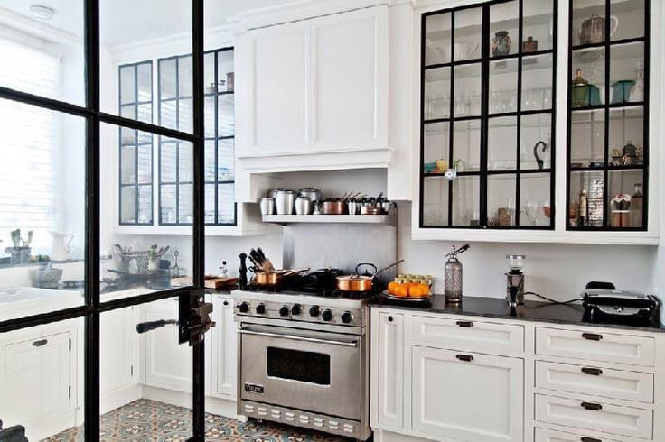 Glass door cabinets.  This is a great way to visually open up your kitchen. If you have some dishes that you'd like to keep hidden, try a mix of glass doored and traditional cabinets.