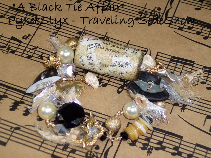 """A Black Tie Affair""  - pwearl and crystal charm bracelet with wine cork focal and ceramic top hat art buttons https://www.etsy.com/listing/201228150/a-black-tie-affair-wine-cork-and-ceramic"