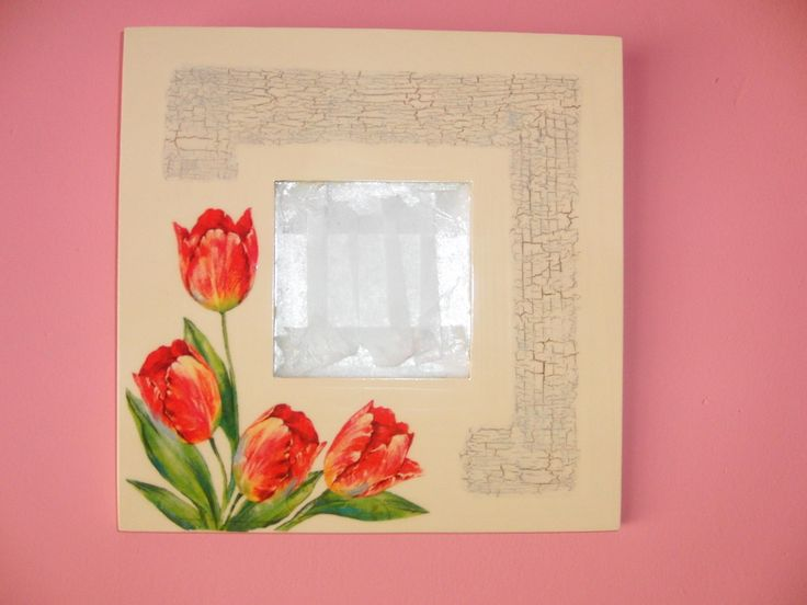 Mirror with red tulips.