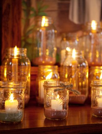 I really love the candles in jars and the ribbons around the jam jars - we could use tartan? Very festive...