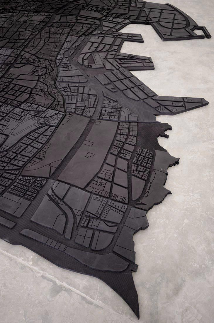 Marwan Rechmaoui is a Lebanese artist whose work often deals with themes of urban development and social history. His Beirut Caoutchouc is a large black rubber floor mat in the shape of Beirut's current map.