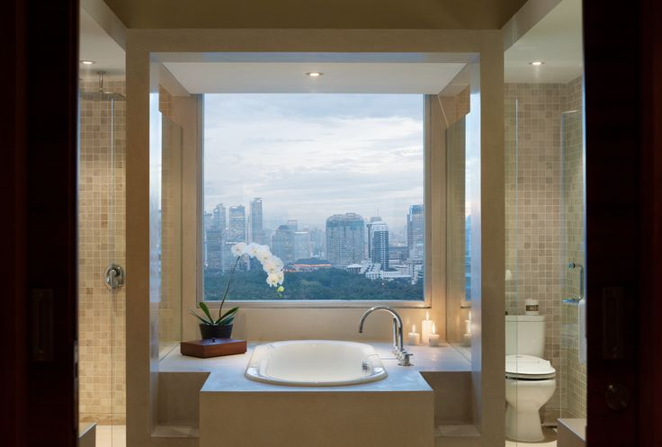 Bathroom with a view at Alila Jakarta