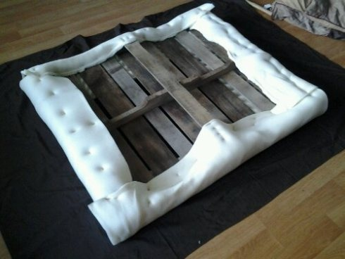 Pallet ottoman – How To DIY....instead of legs, I wonder if I could build a wooden box and put a hinge on one side to make a storage ottoman??