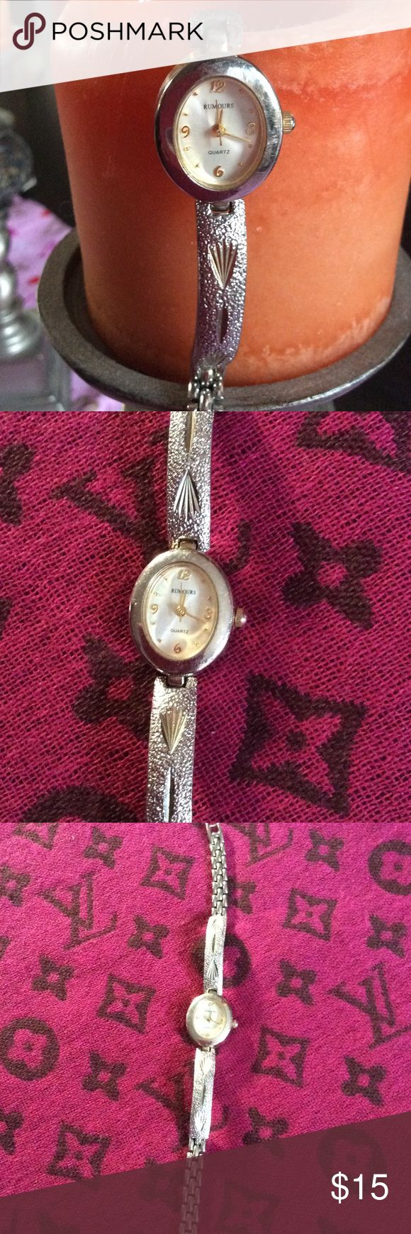 Rumors ladies watch Brushed silver and gold band. 8 1/8 inches approx. when being worn. Very dainty. rumours Jewelry Bracelets