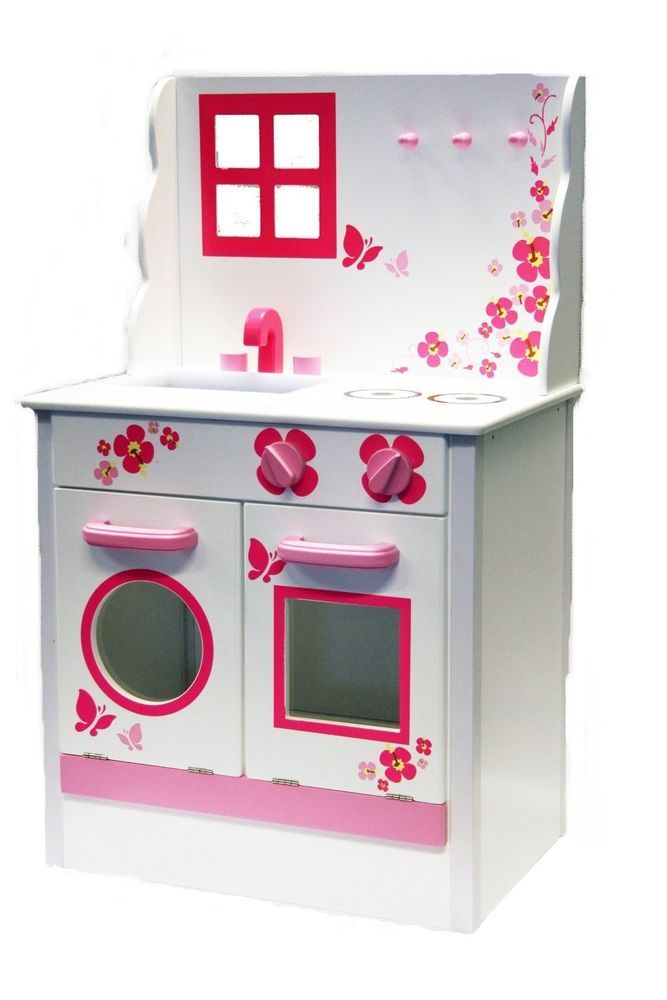 Children s wooden Kitchen including oven and washing machine, sink and hob.