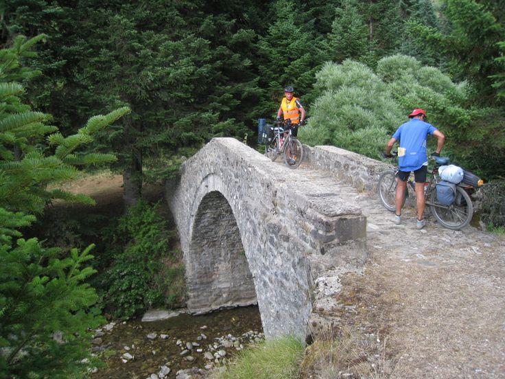 EPIRUS   Inviting, photogenic bridges dot this mountainous region. Giorgos and Dionysus pose for me.