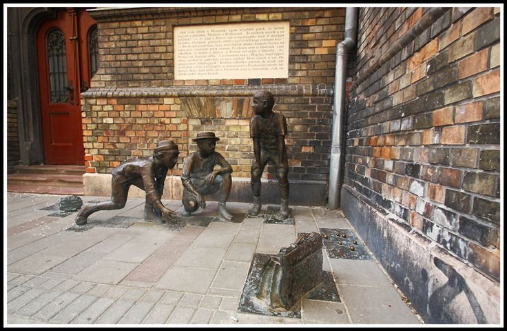 """In Budapest you can find some wonderful hidden statuary. This arrangement of bronze statues outside the elementary school in Práter utca, illustrates a scene from the famous book of Ference Molnár from 1906, """"The Pál Street boys"""""""