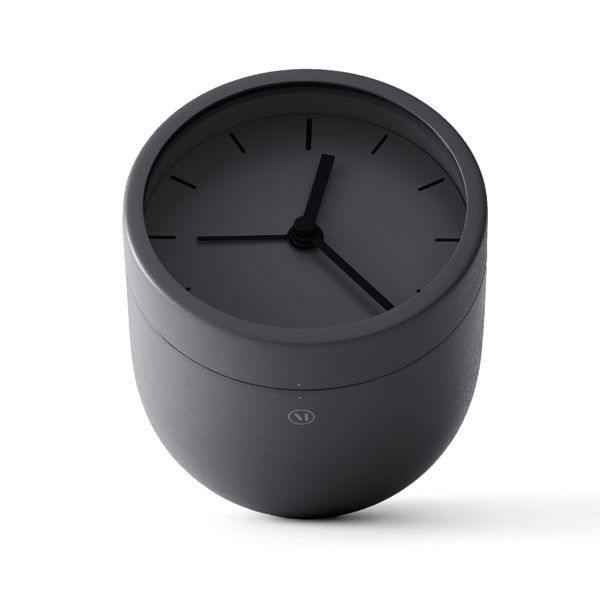 The modern alarm clock by Menu is both fun and a practical item for your nightstand. To turn off the alarm, take the clock and turn it upside down – you'll definitely wake up!