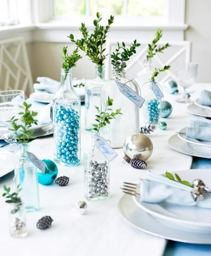 Fill clear bottles with small jingle bells or ornaments for a fun, easy  Christmas centerpiece. Click for more centerpiece ideas.