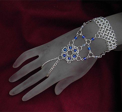 A fantastic chainmail slave bracelet (handweb) design