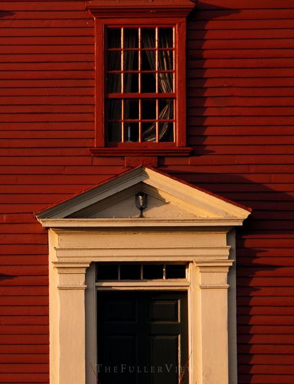 Farmhouse traditional red clapboard exterior with a - Decorative exterior door pediments ...