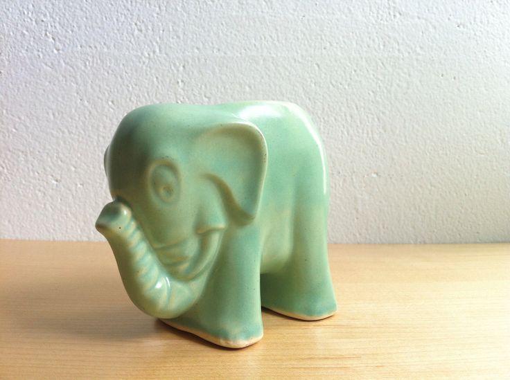 Vintage light blue elephant planter, I believe Shawnee pottery. Cute little guy!
