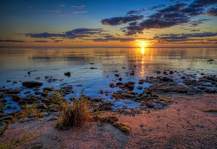 What a sunrise this was. This was taken in Jacksonport, Door County, Wisconsin in late August. The water was smooth as glass, the air was cool and still, and the colors! Wow! To purchase a print, please visit www.scottnorrisphotography.com