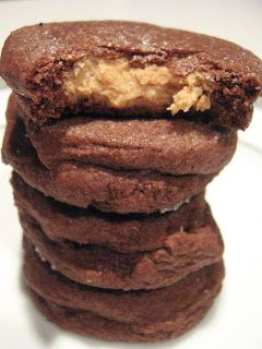 Chocolate Peanut Butter Surprise Cookies.  Filling: 3/4 cup confectioners' sugar 3/4 cup peanut butter  Cookie: 1/2 cup sugar 1/2 cup packed brown sugar 1/2 cup (1 stick) butter or margarine, softened 1/4 cup peanut butter 1 tsp vanilla 1 egg 1 1/2 cups flour 1/2 cup cocoa powder 1/2 tsp baking soda