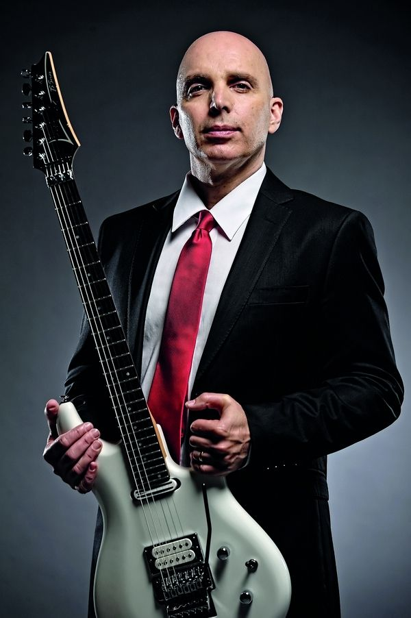 I like joe satriani better bald than in the 90s with his weird curly mullet