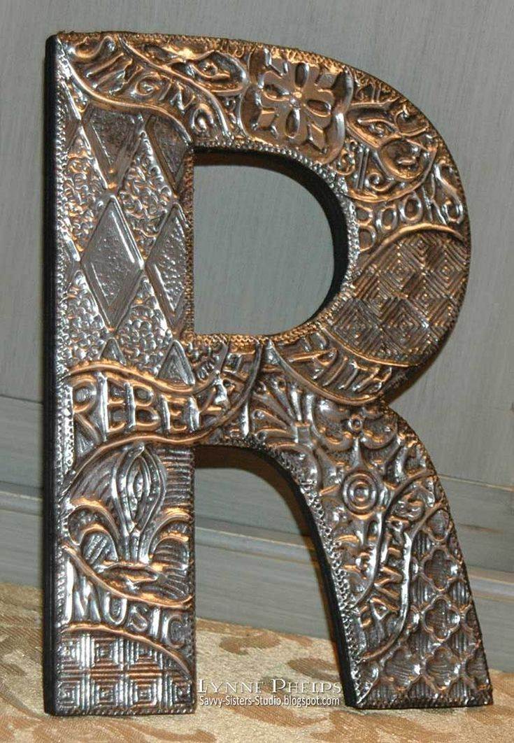 This would be a great lesson for middle school.... die cut letter on chip board, draw on it with glue and wrap in aluminum foil to show the texture/design!