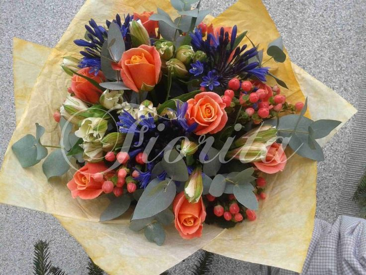 A bouquet of roses, alstroemerias, hipericum and agapanthus
