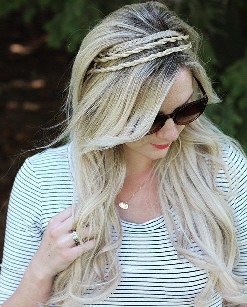 Don't have a hairband on hand? Get strands out of your face by pulling them into a subtle accent braid crown. Work in one, two or several braids and secure underneath the hair with bobby pins.