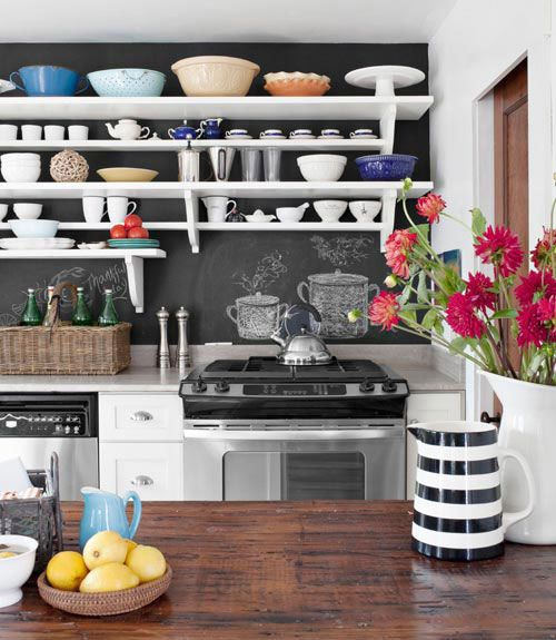 love, love, love this kitchen! not usually a fan of chalkboard paint or open shelving, but it works here. and the striped pitcher! fuschia flowers! wood island!