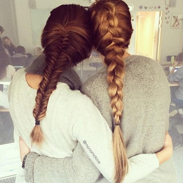 Two best friends showing off their lovely braided hairstyles